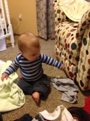 Just up from early morning nap, helping me put his laundry away.